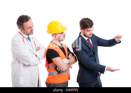 Businessman near medic and constructor holding something big in his hands with copyspace isolated on white - Stock Photo