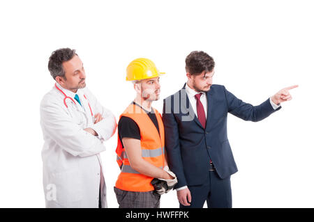 Men with different professions looking at something which businessman is pointing at isolated on white - Stock Photo