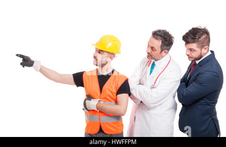 Builder or engineer indicate something to successful doctor and lawyer isolated on white background - Stock Photo