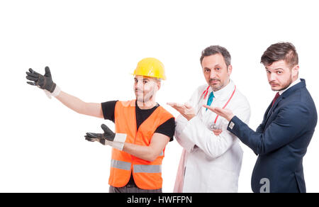 Group of three handsome men presenting something and smiling isolated on white studio background - Stock Photo