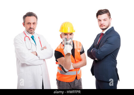 Serious builder is watching you while standing near medic and businessman with folded arms on white background - Stock Photo