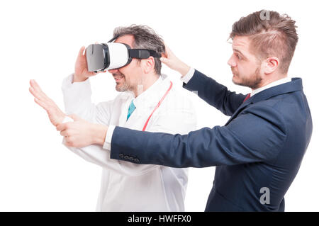 Handsome businessman with young medic looking through vr headset isolated on white