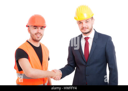Smiling builder and businessman greeting each other by handshake isolated on white background