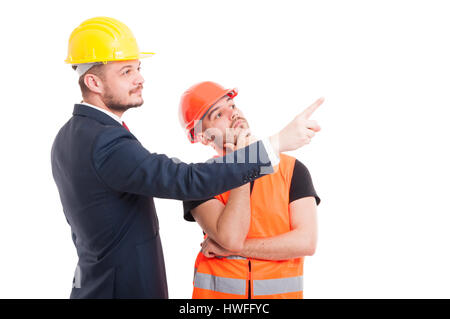 Businessman indicate or pointing something to builder or architect isolated on white background - Stock Photo