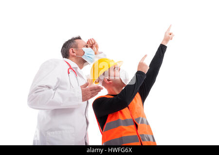 Low angle or hero shot constructor showing far away something at doctor isolated on white background - Stock Photo