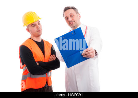Doctor showing something on clipboard to constructor and looking surprised isolated on white background - Stock Photo