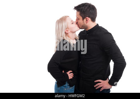 Loving couple kissing passionately on white studio background with copyspace - Stock Photo