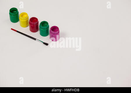 Watercolor paints and paint brush against white background - Stock Photo