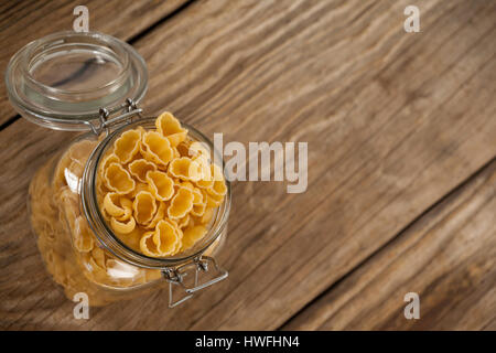 Conchiglie pasta in a jar on white background - Stock Photo