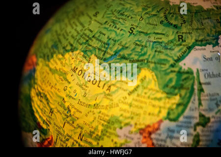 Close up of old fashioned world globe a ball shaped map lit from antique compass on map close up of old fashioned world globe a ball shaped map lit from within focusing on gumiabroncs Images