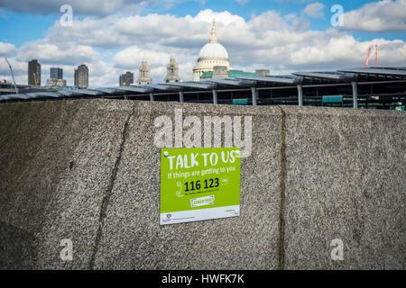 Samaritans sign on Blackfriars Bridge, London, UK - Stock Photo