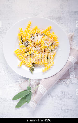 Fusilli pasta with sage and pine nuts. Gluten free. Flour from rice and corn flour - Stock Photo