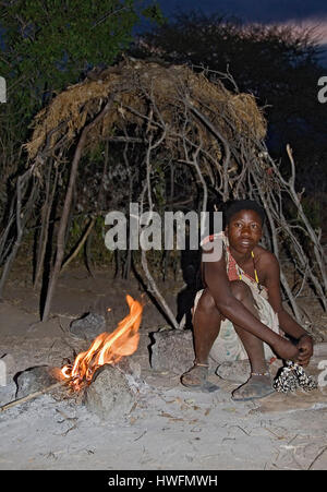 Hadzabe woman in front of her simple hut.  Lake Eyasi, northern Tanzania. - Stock Photo