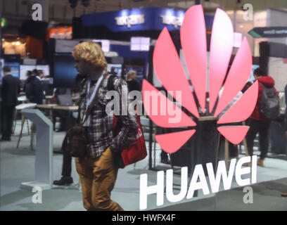 Hanover, Germany. 20th Mar, 2017. A visitor walks through the booth of Huawei during the CeBIT 2017 in Hanover, - Stock Photo