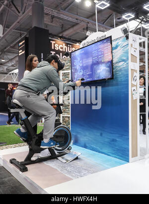Hanover, Germany. 20th Mar, 2017. A visitor experiences VR technology at the booth of ZTE during the CeBIT 2017 - Stock Photo