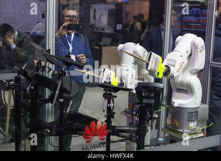 Hanover, Germany. 20th Mar, 2017. Photo taken on March 20, 2017 shows two robots performing percussion instruments - Stock Photo