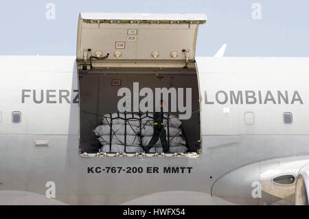 Lima, Peru. 20th Mar, 2017. A worker unloads humanitarian aid for flood victims from a plane of the Colombian Air - Stock Photo