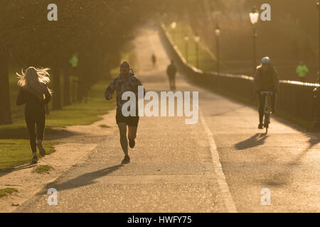 London, UK. 21st Mar 2017. Joggers in Hyde Park this morning during sunny weather. London has seen a sunny and warm - Stock Photo