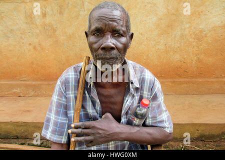 World War II veteran Aloysius Lubega is seen in front of his home in Mugomba village, Uganda, on February 09, 2017. - Stock Photo