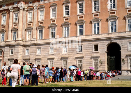 Caserta, Italy - 24 August 2016 - Queue of tourists in front of The Royal Palace of Caserta (italian: Reggia di - Stock Photo