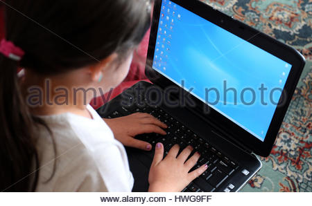 Embargoed to 0001 Tuesday March 21 PICTURE POSED BY MODEL File photo dated 21/08/14 of a child using a laptop computer. - Stock Photo