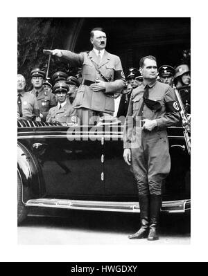 Chancellor Adolf Hitler and his personal representative Rudolf Hess, right, during a NSDAP parade in Berlin, Germany, - Stock Photo