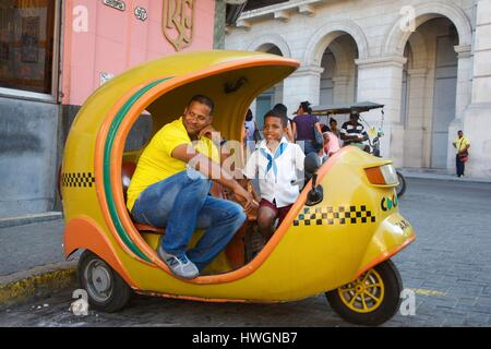 Cuba, La Havana, old Havana, listed as World Heritage by UNESCO, coco taxi driver with his son in front of la Floridita, - Stock Photo