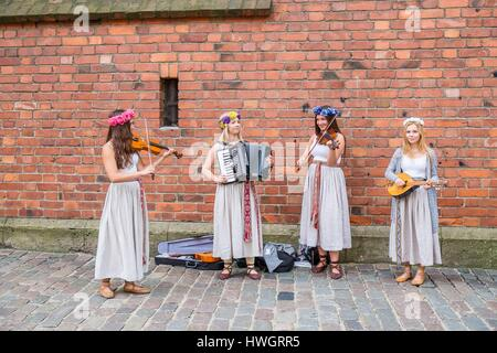 Latvia (Baltic States), Riga, historical center listed as World Heritage by UNESCO, group of girls playing medieval - Stock Photo