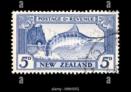 Postage stamp from New Zealand depicting a swordfish jumping after being caught by a sport fisherman. - Stock Photo