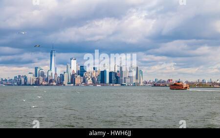 Staten Island Ferry and Lower Manhattan Skyline - New York, USA - Stock Photo