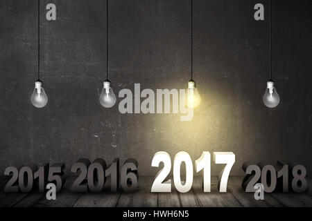 Happy new year and light bulbs only illuminate number 2017 on wooden floor - Stock Photo