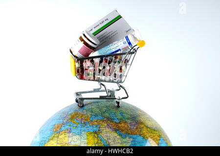 Cart on a globe with medicine and pills, shopping carts on a globe with drugs and tablets globes, globe, globe, - Stock Photo