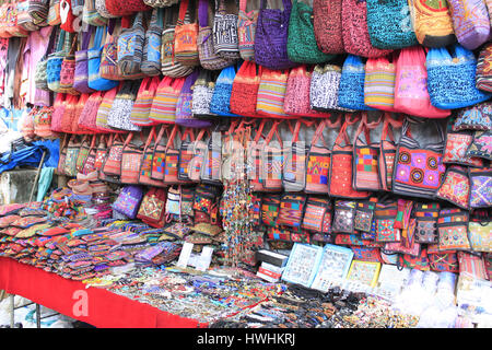 Colorful bags and trinkets on display in a shop. Goa, India - Stock Photo