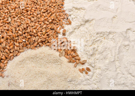 Grains wheat and flour on a wooden table. Concept of making food from cereals. Rustic background. Copy space - Stock Photo