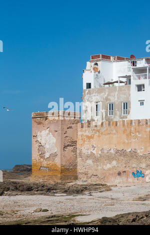 Essaouira port in Morocco, view on old architecture and city wall at ocean. Clear blue sky with seagulls. Vertical - Stock Photo