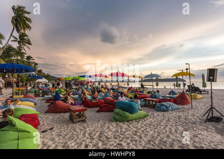 LANGKAWI, MALAYSIA - JANUARY 19, 2017: Tourists enjoy a drink in a beach bar on Cenang beach in Langkawi, an island - Stock Photo