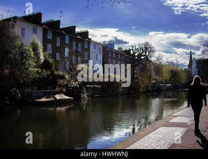 Regents canal  tow path pedestrian walking away - Stock Photo