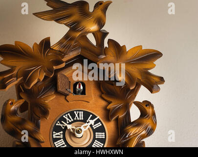 A cuckoo clock on a wall. - Stock Photo