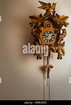 A cuckoo clock on a wall. - Stock Photo
