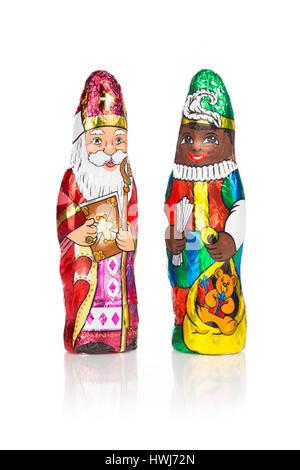 Closeup of Sinterklaas and Black Pete. Saint  Nicholas chocolate figurine of  Dutch character of Santa Claus.Isolated - Stock Photo