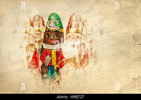 Close up of Sinterklaas and Black Pete on old paper . Saint  Nicholas chocolate figure of  Dutch character of Santa - Stock Photo