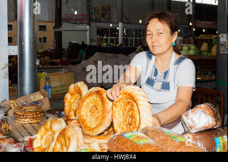 Kazakh Woman selling bread, Samal Bazar, Shymkent, South Region, Kazakhstan, Central Asia, For editorial use only - Stock Photo