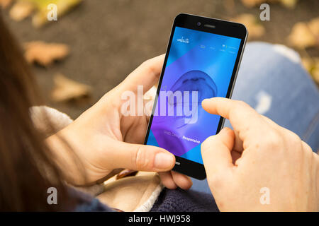 mobile design concept: woman holding a 3d generated smartphone with navigation app on the screen. Graphics on screen - Stock Photo