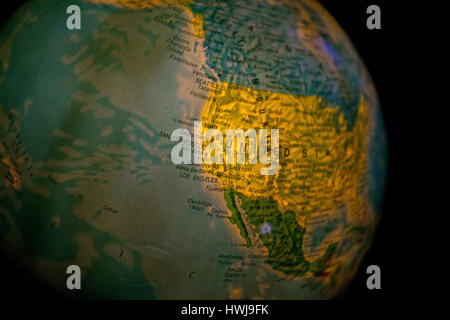 close up of old fashioned world globe a ball shaped map lit from within focusing on Atlantic east coast North America - Stock Photo
