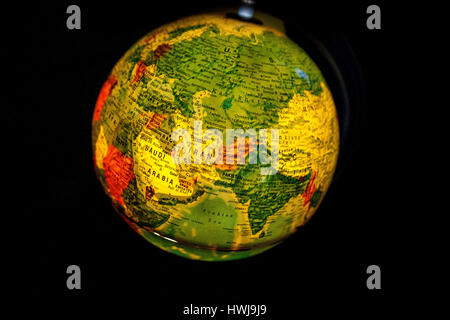 close up of old fashioned world globe a ball shaped map lit from within focusing on Pacific ocean California North - Stock Photo