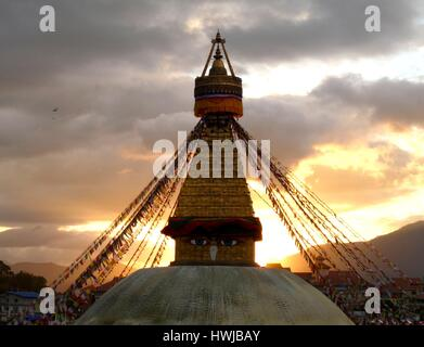 Boudhanath stupa with eyes of Buddha and cascading prayer flags in Tibetan enclave of Kathmandu, Nepal with spectacular - Stock Photo