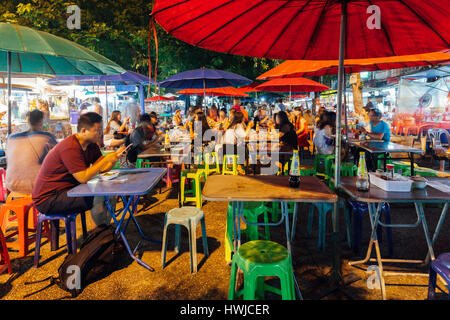 Chiang Mai, Thailand - August 27, 2016:  People eat at the street cafe on Saturday Night Market on August 27, 2016 - Stock Photo