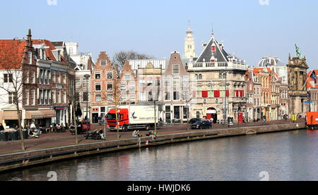 Spaarne river in Haarlem, The Netherlands with De Waag, a former 16th century Weigh house on the right. - Stock Photo