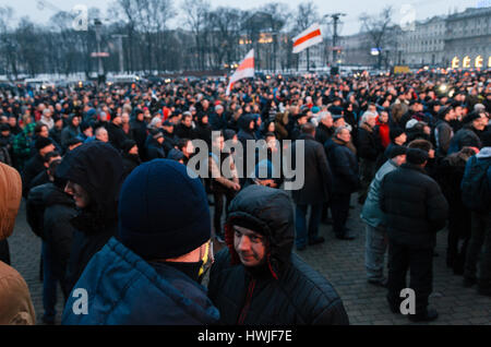 Police officers in plainclothes are among the protesters. Belarusian people participate in the protest against the - Stock Photo