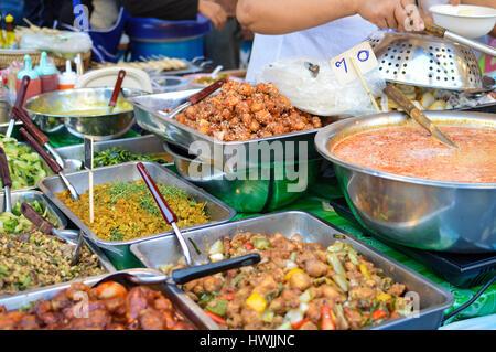 Street food market stalls near Central World mall in Bangkok, Thailand - Stock Photo